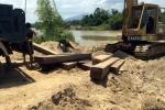 Chở gỗ lậu bị phát hiện, dùng dao chống trả cảnh sát rồi tẩu thoát