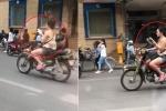 Clip: Không mũ bảo hiểm, cô gái vừa lái xe máy, vừa đọc sách trên phố Hà Nội