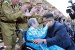 Nha lanh dao Kim Jong-un gap go va tri an cac cuu chien binh Trieu Tien hinh anh 8