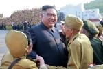 Nha lanh dao Kim Jong-un gap go va tri an cac cuu chien binh Trieu Tien hinh anh 1