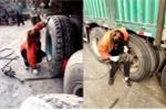 Cô gái xinh đẹp thay lốp xe tải thoăn thoắt khiến cánh mày râu 'lác mắt'