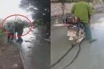 Clip: Vô ý thức chạy xe máy qua đường đang đổ bê tông còn hung hăng đòi đánh người