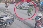Clip taxi kẹp tay, kéo lê thiếu tá công an hàng chục mét trên phố Hà Nội