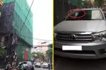 Thanh sắt rơi từ công trường xây dựng xuyên thủng kính xe ô tô 7 chỗ ở Hà Nội