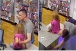 Bố dùng con gái nhỏ làm lá chắn để trộm điện thoại trong cửa hàng