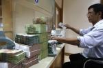 Bơm 700.000 tỷ đồng: Lo tiền vào chứng khoán, bất động sản?