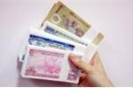 Nhân viên ngân hàng 'thấp thỏm' trước áp lực đổi tiền lẻ mới