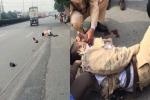 3 thanh niên đầu trần lái xe máy tông CSGT ngã xuống đường bị xử lý thế nào?