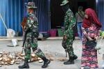 Video: Lính Indonesia được lệnh bắn người hôi của trong vùng thảm họa kép