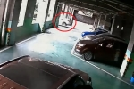 Video: Ô tô đâm thủng tường, rơi từ tầng 2 bãi xe xuống đất