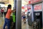 Trung Quốc: Cô gái tay không tháo tung cây rút tiền ATM