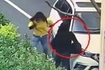 Clip: Ném đá vào kính ô tô, cô gái bị tài xế cán qua người