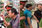 Vì sao không xử phạt 2 cha con chỉ tay vào mặt công an lăng mạ, thách thức đánh nhau giữa Thủ đô?
