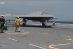 'Sát thủ' tàng hình không người lái X-47B hạ cánh xuống siêu tàu sân bay Mỹ