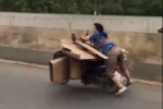 Video: Nữ quái xế liều mạng chở hàng cồng kềnh, phóng như bay ở Trung Quốc