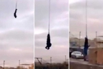 Người đàn ông cắm đầu xuống đất khi nhảy từ cần trục cao hàng chục mét nhưng không chết