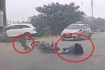 Clip: Chó thả rông lao sang đường như tên bắn, đốn ngã thanh niên đi xe máy