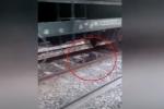 Clip: 'Ma men' sống sót thần kỳ dưới gầm tàu hỏa
