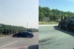 Cố vượt container, xe biển xanh húc bay dải phân cách chắn ngang quốc lộ
