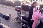 Mẹ trói tay con vào xe máy, kéo lê trên đường