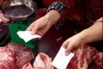 Người Sài Gòn rồng rắn xếp hàng lấy phiếu mua thịt heo