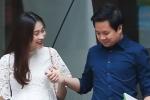 Hoa hậu Đặng Thu Thảo lần đầu lộ bụng bầu, tay trong tay ông xã đi khám thai