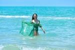 Hoa hau Huong Giang dien bikini nong bong, tinh tu ben Dam Vinh Hung hinh anh 4