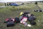 Lục lọi, hôi của giữa các thi thể nạn nhân ở hiện trường MH17 rơi