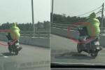 Clip: Thanh niên lái xe máy bằng chân trên cầu vượt biển dài nhất Việt Nam