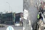 Xe container lật nghiêng đè trúng 2 người đi xe máy ở Hà Nội