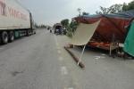 Đứng phơi lúa trên lề quốc lộ, người phụ nữ bị xe tải tông chết