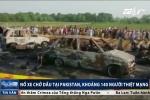 Hôi dầu từ xe bồn gặp nạn, hơn 140 người chết cháy