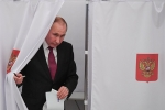 Video: Ông Putin đi bỏ phiếu bầu Tổng thống Nga