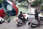 Truy tìm nam thanh niên dùng mã tấu chém vỡ kính chiếu hậu nhiều ô tô ở Sài Gòn