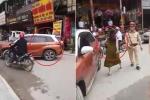 Clip: Bị CSGT nhắc nhở, nữ tài xế đỗ ô tô giữa đường chống đối