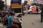 Bị CSGT dừng phương tiện, tài xế taxi leo lên nóc xe ăn vạ