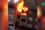 Clip: Cháy chung cư, mẹ liều mình ném con từ tầng 3 xuống đất