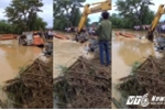 Vỡ đê ở Thanh Hóa: Video cận cảnh ném cả máy múc hàng trăm triệu xuống hàn đê, cứu dân