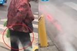 Clip: Đi bộ sai luật ở Trung Quốc, bị phạt... xịt ướt quần