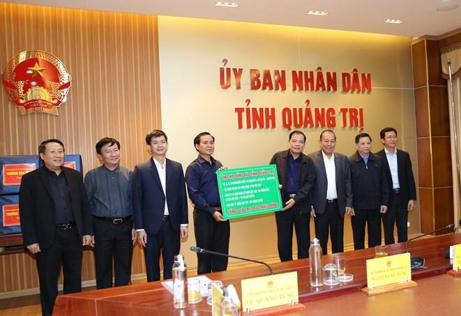 Phó Thủ tướng Trương Hòa Bình chỉ đạo công tác khắc phục hậu quả bão lụt - 3