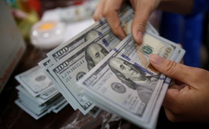 USD có phiên tăng nhanh bất ngờ ngày 28/1.