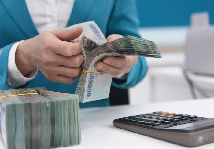 Doanh nghiệp lao đao vẫn trả lãi cắt cổ, ngân hàng lãi lớn - 1