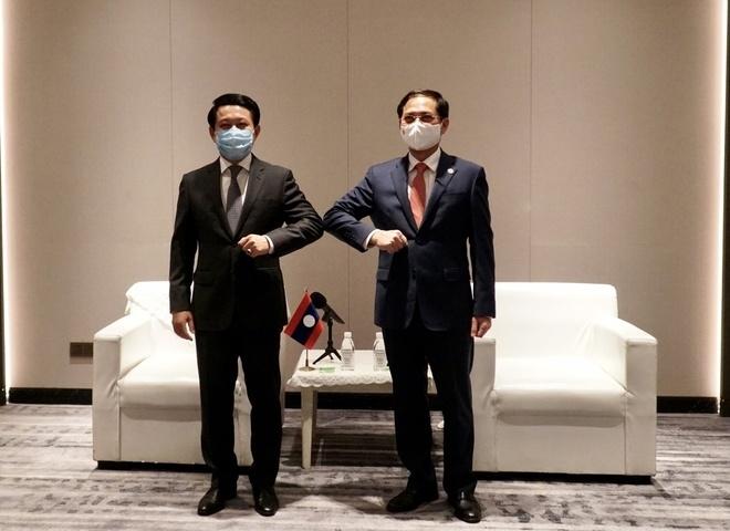 Bộ trưởng Ngoại giao Bùi Thanh Sơn gặp song phương Bộ trưởng Ngoại giao Lào - 1