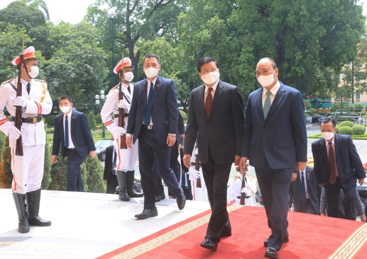 Chủ tịch nước Nguyễn Xuân Phúc hội kiến Tổng Bí thư, Chủ tịch nước Lào - 1