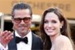 Angelina Jolie và Brad Pitt cùng chăm con sau phẫu thuật