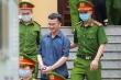 Kẻ chủ mưu vụ gian lận thi ở Hòa Bình lạnh lùng chối tội, tươi cười khi rời tòa