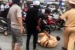 Anh trai bị bắt xe, 2 người em đến xô ngã, đánh cảnh sát giao thông