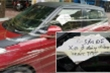 Xe ô tô bị dán băng keo cùng dòng chữ 'lần sau đỗ xe ở đây đừng trách tao'
