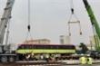 Ảnh:  Đoàn tàu thứ 3 tuyến metro Nhổn - ga Hà Nội được đặt lên đường ray