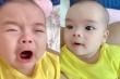 Em bé vừa gào khóc vừa hé mắt canh chừng bố